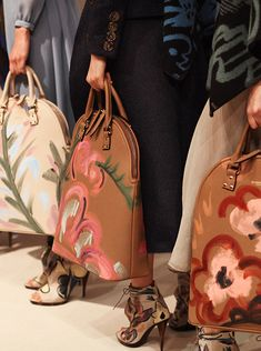 The Bloomsbury - a line-up of hand-painted runway bags backstage at the Burberry A/W14 show