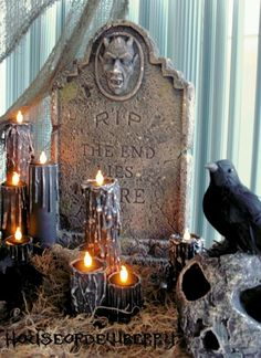 Easy DIY dripped candles using papertowel rolls and tea lights.... http://houseofdewberry.blogspot.com/2010/08/diy-halloween-project-black-candles.html?m=1