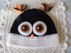 A beanie shaped hat in the form of an owl black and white with large eyes hand crochet in machine washable acrylic yarn embroidered details fits 2 to 5 years any other size can be made tassels for his ears measures 18 round 46 cms crown to brim 19 cms Owl Eyes, Large Eyes, Owl Hat, Beanie Hats, Hand Crochet, Handmade Crafts, Tassels, Cool Style, Black And White