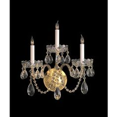 3 Light crystal wall sconce with polished brass finish
