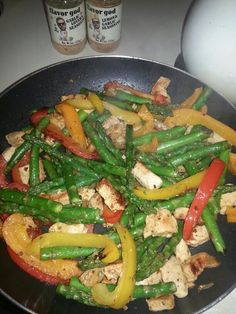 Very simple pan of goodness. Sauteed cut up chicken breast seasoned with Flavor God seasonings,  bell peppers, asparagus, olive oil, black pepper. Took 30 minutes with prep.
