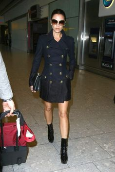 Victoria Beckam in a black short dress with black short boots. A Fave!