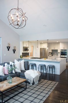 Open Concept Living Room and Kitchen | Open Concept Living Room | Open Concept Kitchen | Shiplap Island | Herringbone Table Top | Neutral Home Décor Ideas | Lovesac Sactional | White and Gray Kitchen | Modern Farmhouse Decor