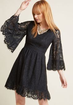 Bell Sleeve Lace Dress in Black - Your day off is dreamy as can be thanks to this vintage-inspired dress - part of our ModCloth namesake label! Flaunting the lovely lace overlay, V-neckline, and ruffled hemline of this black, bell-sleeved frock, you sway to a blossom-lined pathway nearby, giving the nature-filled scene a run for its beauty.