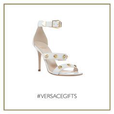 Party in white: these glamorous #Versace Signature studded sandals will make a superb impression to your next cocktail event. #VersaceWomenswear #VersaceGifts
