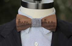 Give a super unique gift and also have your guy looking great for the New Year's parties right around the corner with a bow tie from Two Guys.