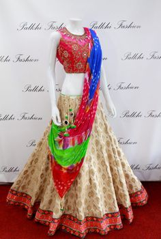 Exclusive Full Flair Gold Brocade Silk Lehenga with Mirror Work Blouse and Bandhni Duppata.