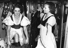 Dancers of the Blue Train cabaret troupe get into their costumes for a performance at the Prince of Wales Theatre in London. 7th June 1927.