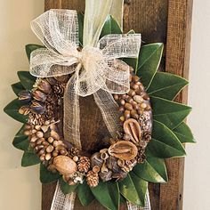 Acorn Wreath - Collect small acorns, nuts, and other items from the yard and attach them to a wreath form that is wrapped in a chocolate brown ribbon. Glue the wreath to a bed of magnolia leaves. Thanksgiving Wreaths, Fall Wreaths, Door Wreaths, Christmas Wreaths, Christmas Crafts, Christmas Decorations, Holiday Decorating, Decorating Ideas, Craft Ideas
