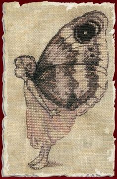 Nimue Le Papillon (The Butterfly) - Cross Stitch Pattern. Model stitched on 32 Ct. vintage linen with DMC floss. Stitch Count: 58x99. Also required, but not lis