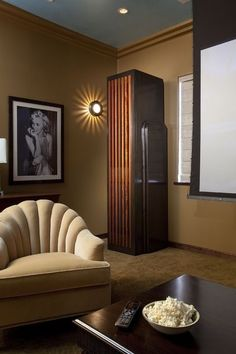 Posted this just for the lighting.    Eclectic media room by Tongue & Groove