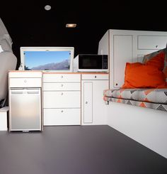 Custom campervan with 240 volt outlets and Sharp Compact Microwave for quick rainy day cooking! Find out more at www.achtungcamper.com.au