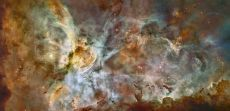 Zoomable - Star birth in the extreme. Name:Carina Nebula, NGC 3372 Type:Milky Way : Nebula Distance:7500 light years Constellation:Carina Category:Nebulae