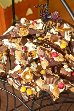 Halloween Candy Bark - I did it quick and dirty with what I had in my cupboards-pretzels, marshmallows, and M's in the bittersweet chocolate-turned out great and went together super fast.