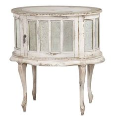 "$895 Bellemaison Mirrored White French Side Chest Gorgeous vintage French ""provence"" drink cabinet with authentic antiqued mirror panes and antiqued pulls. This lovely table features ornate and beaded carvings and curved legs. Finished in distressed cygne blanc (white with subtle grey tones). The top has a subtle soft blue painted edge with a swirly motif.  Dimensions: 30.75""H X 19""D X 28.5""W  Stock: In Stock (Verify Below)  Shipping: Ships Within One Week"