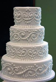 Tiered White Cake with Lace Piping...with some pink on here it would be a good choose for my Wedding cake