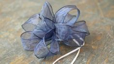 Knowing how to tie a bow is an essential skill for anyone who enjoys wrapping presents, decorating for parties, and the holidays. Here are three easy ways you can make your own bows with ribbon. Diy Bow, Diy Ribbon, Wired Ribbon, Ribbon Crafts, Ribbon Bows, Ribbons, Wreath Bows, Mesh Wreaths, Types Of Bows