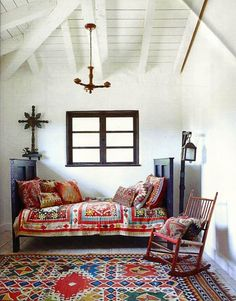 Bohemian cottage, I adore the white rafters and wood flooring but again its a little too modern for my taste. Adore the funky quilt though!