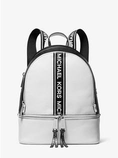MICHAEL KORS Rhea Medium Logo Tape Backpack Laid-back yet luxe, our Rhea backpack redefines big-city accessorizing. We love how the logo taping adds sporty appeal to the color-blocked pebbled… Tote Bags, Backpack Bags, Guess Backpack, Crossbody Bags, Lv Handbags, Handbags Michael Kors, Designer Handbags, Designer Bags, Chanel Handbags