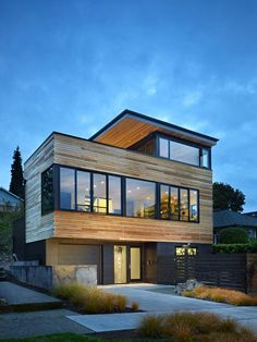 like the textures and shape of this home. large windows on front feel inviting
