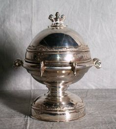 American silver plate dome covered butter dish with rams head handles.