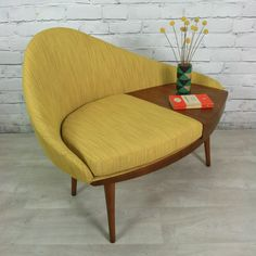 A very unusual & scarcely seen telephone seat with curves in all the right places! Superb ergonomic shape coupled with Iconic era defining splayed legs. Manufactured by 'Chippy Heath' of Great Britain. Fully restored, all the internal foam and inners have been stripped back and replaced then upholstered with a gorgeous mustard fabric to make it fully compliant to fire regulations. Dimensions: Total height: 80cm Height to seat: 45cm Width: 100cmDrawer width: 29cm Drawer depth...