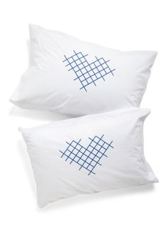 Cross-stitch My Heart Pillowcase Set. After a busy day of crafting, rest your head against one of these two heart-printed pillowcases by Kin Ship, and dream up even more brilliant ideas. #white #wedding #modcloth