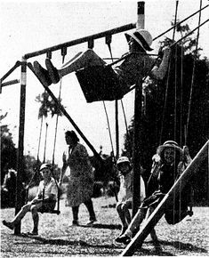 Children on swings at Tui Glen during the Easter holiday. April 1939. White hats