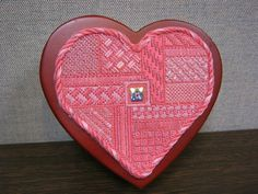 Needlepoint and beaded heart mounted on heart shaped box.  I made this for Kendal for her birthday.
