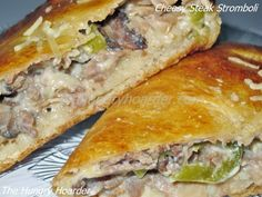 Cheesy Steak Stromboli - All the flavors of a philly cheese steak sandwich wrapped up neatly in a baked pizza crust. Next time I would probably omit the seasoning as the deli meat and cheese added enough salt to it.