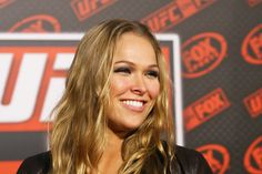 Ronda Rousey - This girl will snap your arm in two.