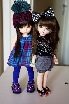 cute girls....olivia's fancy look would be the one on the right:)