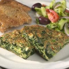 Greek Omelet  With flavors reminiscent of the classic Greek spanakopita, this easy omelet is just right for a light dinner or brunch. Frozen leaf spinach makes it ultra-quick.