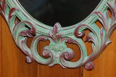 "Remade Hollywood Regency Syroco Mirror. Annie Sloan Chalk Paints Antibes Green, Primer Red, Versailles. 29"" X 17.5"" $125"