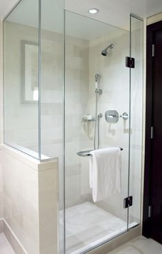 Fully Enclosed Shower frame-less glass enclosure add elegance to this over sized shower