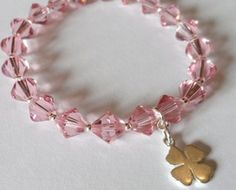Beautiful Sparkling Swarovski Pink Crystals make this bracelet a perfect  accessory for spring & summer. Each crystal is seperated by 925 silver beads  and a simple 925 silver clover finishes the bracelet off. A dazzle of summer colour. Beautiful on its own or worn with the contrasting Summer Sun and Ocean Dreams bracelets. www.blueapplejewellery.com