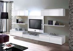 Mesmerizing White Minimalist Style Tv Wall Unit Featuring Grey Walls And Good Pattern Curtain In Black White And Cream Wooden Floor Together With Black Coffee Table And Also Black Standing Lamp. Luxury Look Of Wall Units In Modern Homes Interior Design Blogs, Modern Entertainment Center, Entertainment Centers, Kitchen And Bath Design, Custom Kitchens, Grey Walls, Decoration, Modern Furniture, New Homes