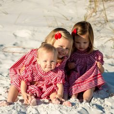 The Christmas Collection from Southern Living by Smocked Auctions. Classic red check outfits for boys and girls.
