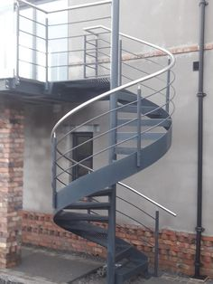 Spiral Staircase, with perforated tread plates and mild steel and stainless handrail