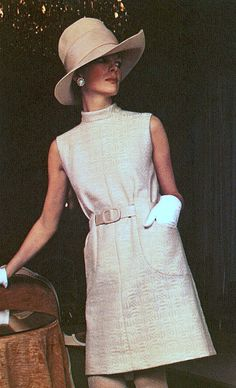 1969 Valentino. Italian Vogue,April late 60s casual day dress cream white winter wool sleeveless belted pockets high neckline mock turtleneck gloves hat tan color photo print ad model magazine space age modern