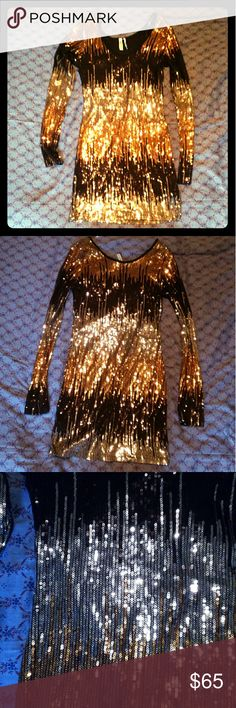 AMAZING sequin party dress fitted, USA Made! Amazing fitted stretchy long sleeve party dress covered in sequins (black,gold, and silver beautifully blended). You will have to tell everyone to stop staring, it's just that good. Perfect condition. Guess by Marciano Dresses