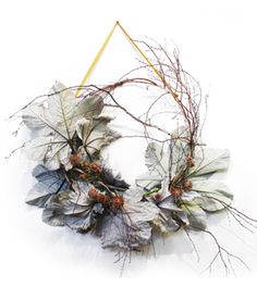 SILVER BIRCH WREATH  This Silver Birch Wreath is an example of a special, custom designed wreath. We offer one of a kind wreaths for the home or a special event starting at $500. This wreath is constructed with a white birch frame, tropical cecropia leaves and leukadendron.