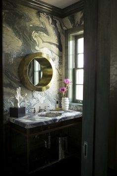 21 Perfect Powder Room Wallpaper Ideas: A super luxe marble print adds drama to this moody bath.