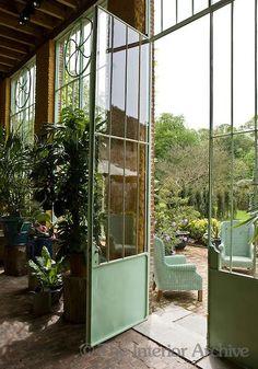 """focus-damnit: """" A view of the garden through the elegant metal door of the conservatory. (In Belgium) """""""