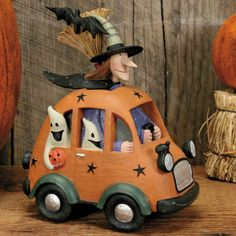 Witch in Car with Ghosts Figurine