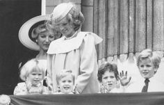 June 16, 1984:  Princess Diana and Princess Michael of Kent (behind) look on, as royal children applaude from the balconey of Buckingham Palace during ceremonies marking the official birthday of Britain's Queen Elizabeth II. The children are from left: Zara Phillips, the daughter of Princess Anne, Prince William, and son of the Prince and Princess of Wales. Princess Diana is pregnant in this photo with her second child. (AP)