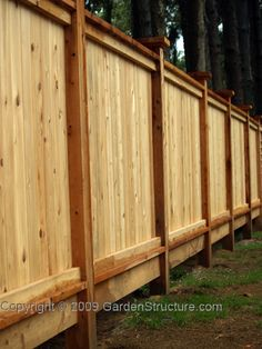 This is a heavyweight red cedar fence that appears the same from both sides.  Designed to withstand wind featuring larger rails and 6x6 posts.