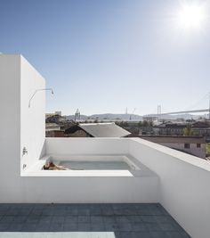 OUTDOOR SHOWERS & BATHS - Rooftop bathing in a Lisbon home by José Adrião Arquitectos. Photo by Fernando Guerra of FG+SG.