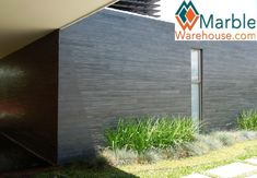 Black slate cladding in strip form - Eazyclad Natural Stone Cladding Cladding Panels, Exterior Cladding, Wall Cladding, Natural Stone Cladding, Slate Flooring, Slate Tiles, Stone Facade, House Extensions, House Front
