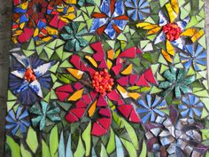 a mass of flowers , a mosaic by kat gottke
